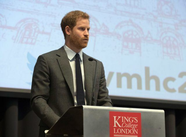 Prince Harry speaking to an audience while behind a podium.