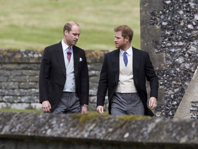 Prince Harry and Prince William walking together on Pippa Middleton's wedding day.