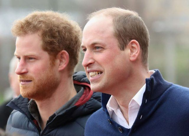 Prince William and Prince Harry standing next to each other.