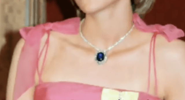 Princess Diana wearing a blue sapphire necklace.