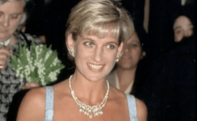 Princess Diana wearing the pearl necklace with a blue dress.