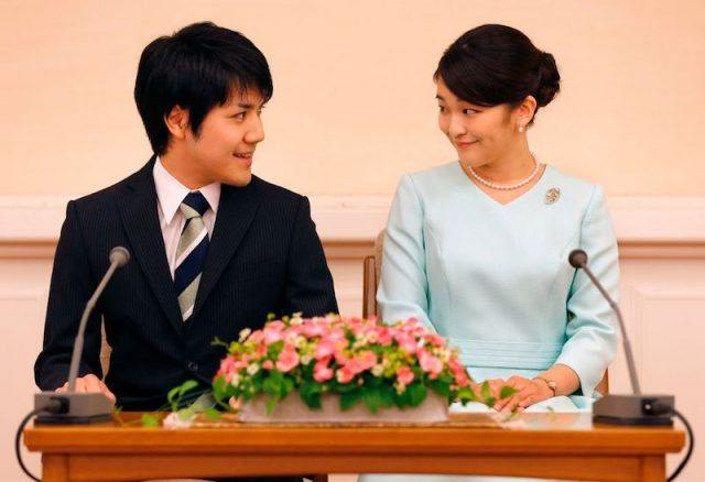 Princess Mako and her fiancee Kei Komuro smile at each other during a press conference to announce their engagement.