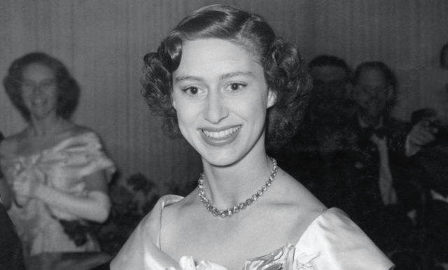 Princess Margaret smiling while in a gown.