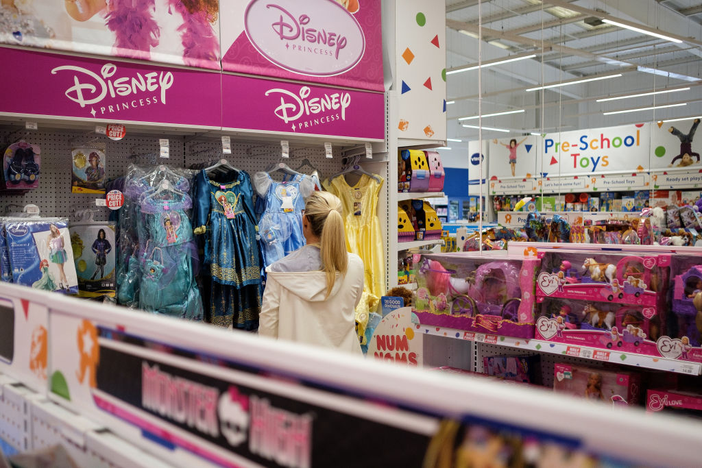 Woman looks at princess dresses at Toys R Us