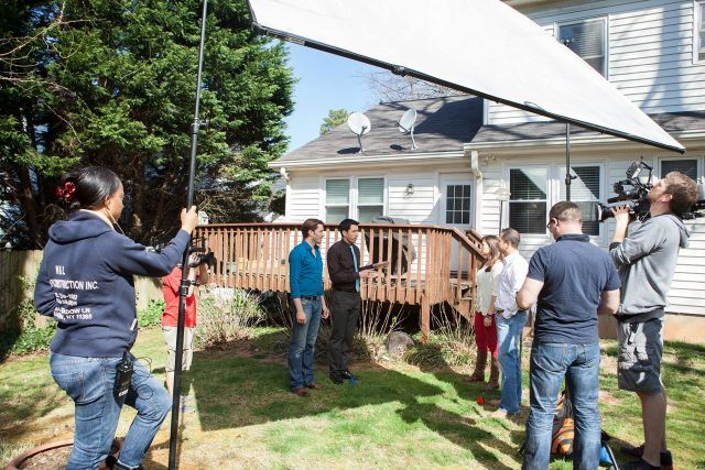 The Property Brothers filming a scene.
