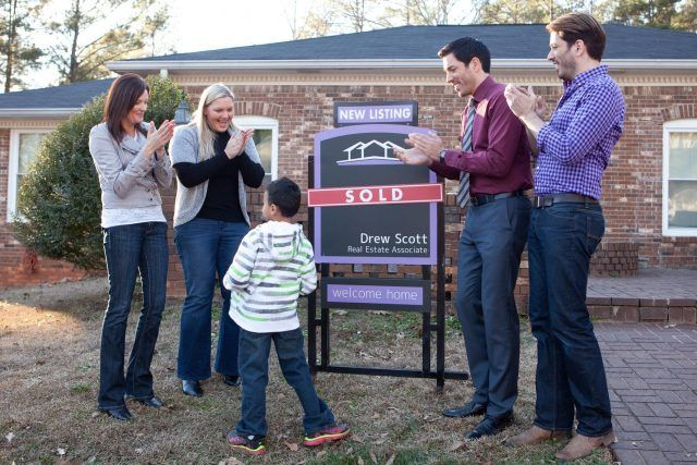 A couple applauded as they find their new home.