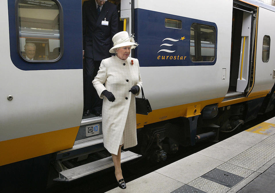 Queen Elizabeth II steps out of a Eurostar train as she arrives at the Gare du Nord station