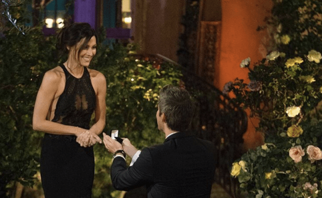 Rebecca smiling as Arie proposes.