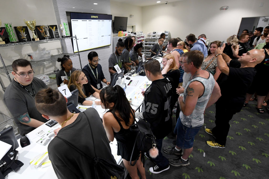 Customers buy cannabis products at Essence Vegas Cannabis Dispensary after the start of recreational marijuana sales began in Las Vegas, Nevada