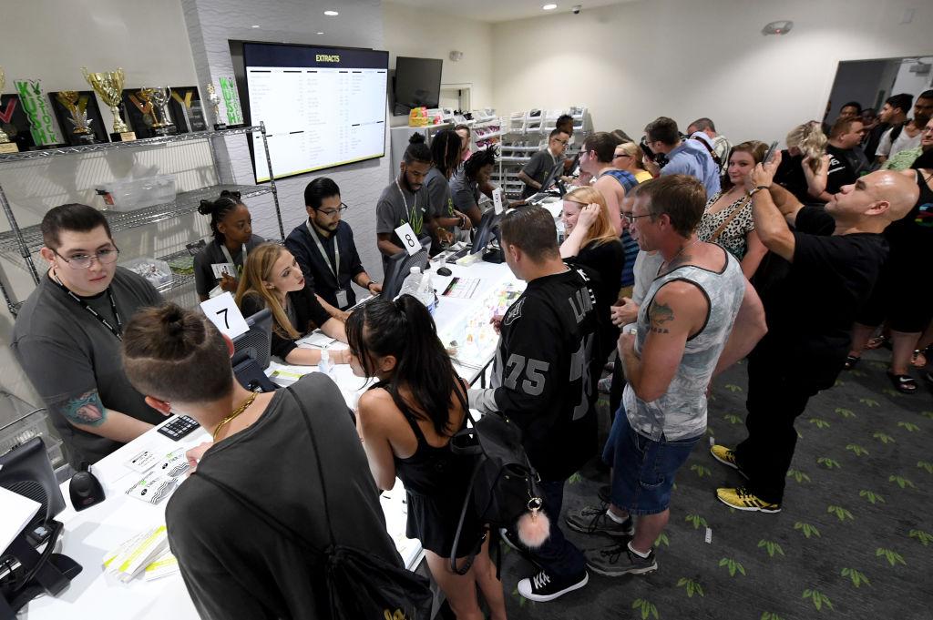 Customers buy cannabis products at Essence Vegas Cannabis Dispensary after the start of recreational marijuana sales began in Las Vegas, Nevada