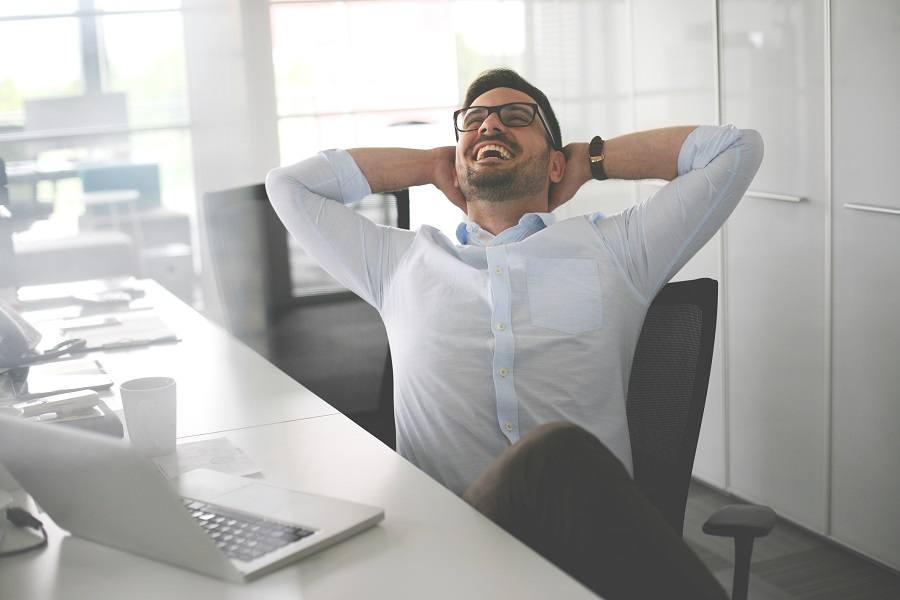 Man in office relaxing