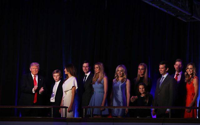 Donald Trump acknowledges the crowd along with his family during his election night event