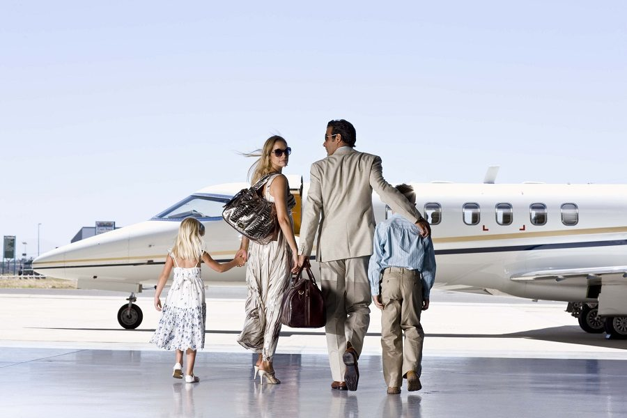 A well-dressed family ready to board a plane