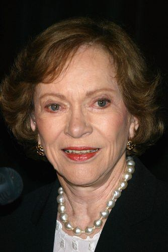 Rosalynn Carter smiling while wearing pearls.