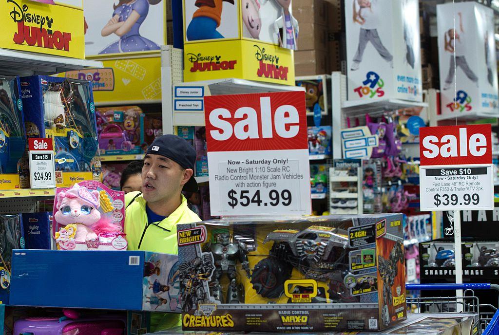 Customer walking near toys on sale