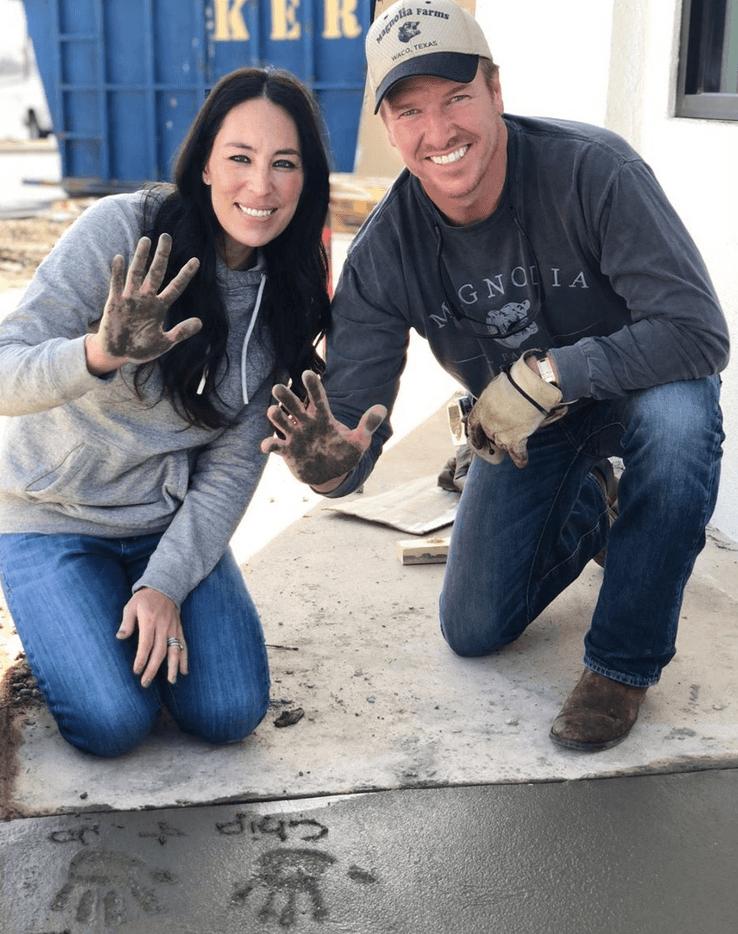 Chip and Joanna making handprints