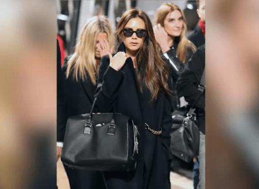 Victoria Beckham in all black.