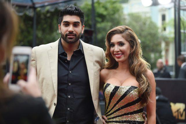 Farrah Abraham posing with her boyfriend on a red carpet.