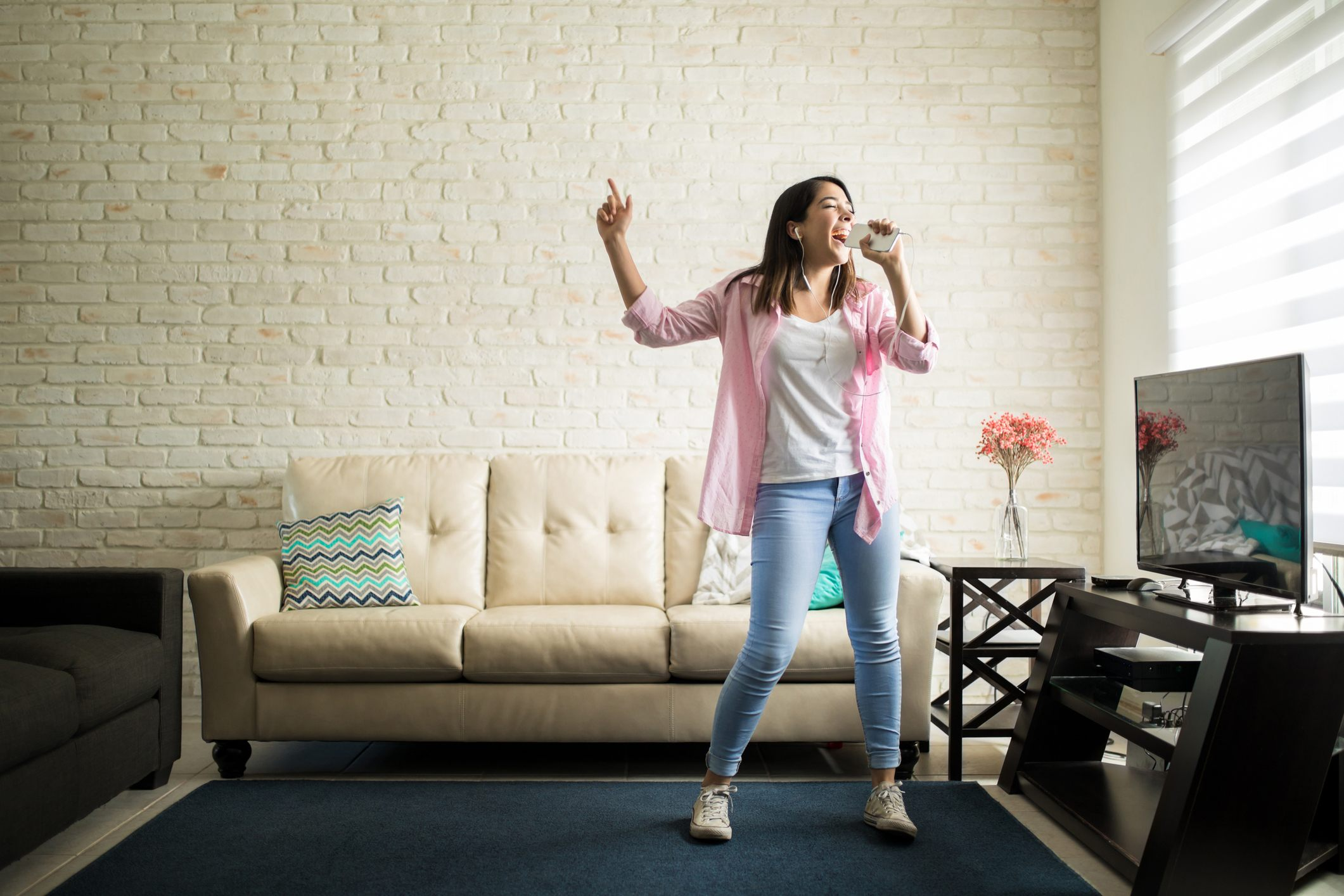 Woman singing at home