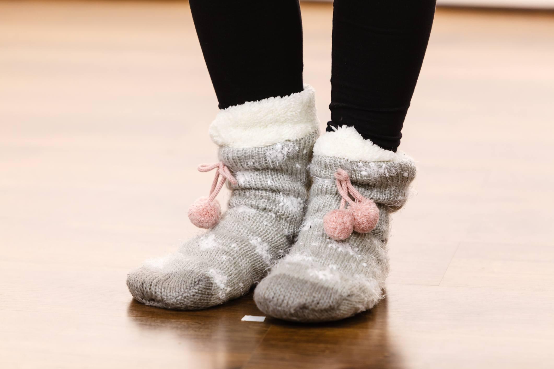 Girl wearing winter warm slipper socks