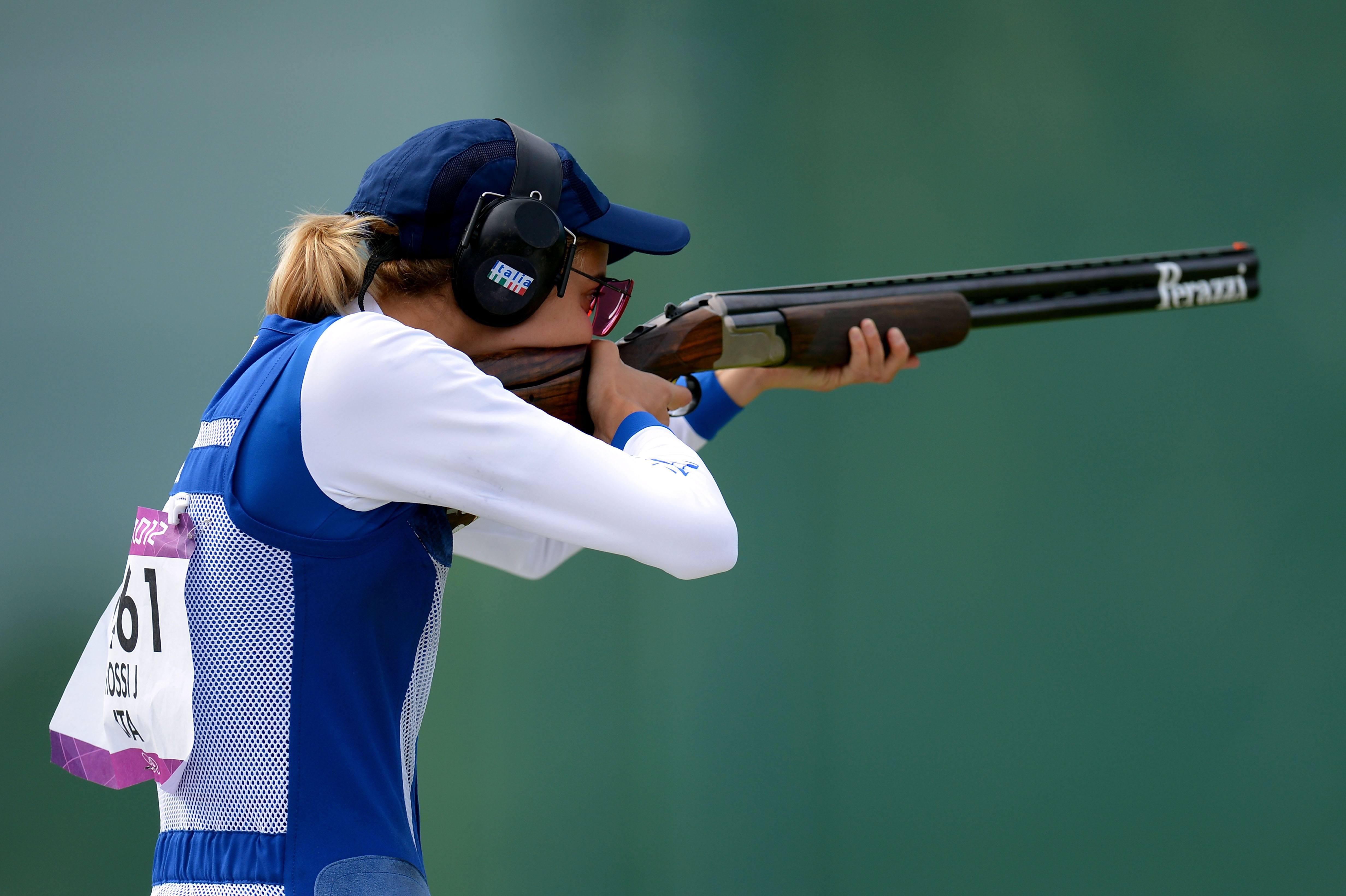 Girl shooting a gun during the olympics