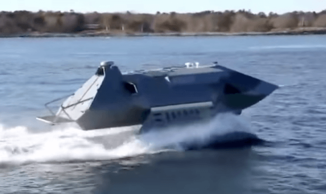 A stealth boat on the water.