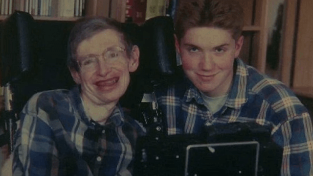 Stephen Hawking and Timothy Hawking wearing matching flannels in a photo.