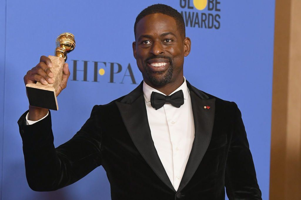 Actor Sterling K. Brown holds his award