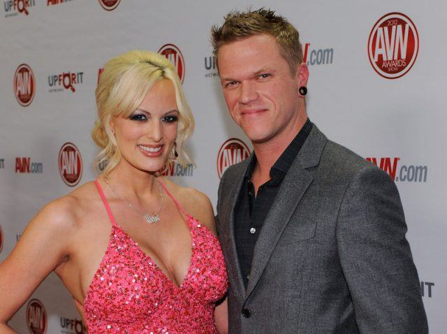 Stormy Daniels and Brendon Miller together on a red carpet.