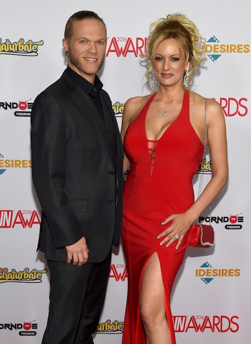 Stormy Daniels and her husband on a red carpet.