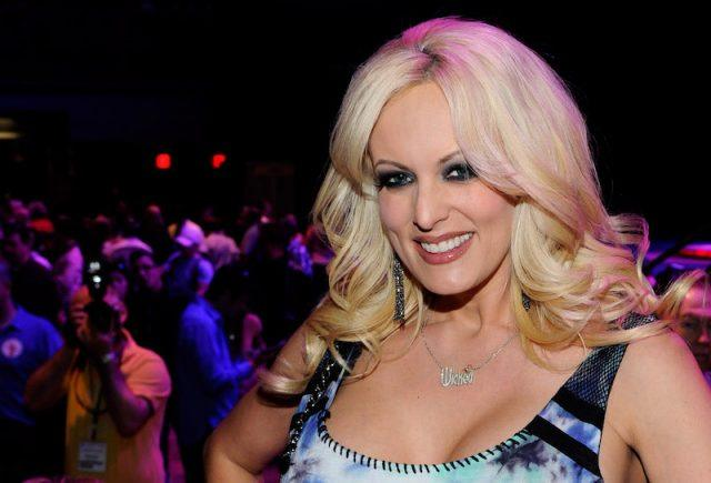 Stormy Daniels signing autographs and meeting fans.