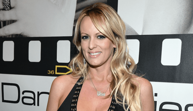 Stormy Daniels smiling on a red carpet.