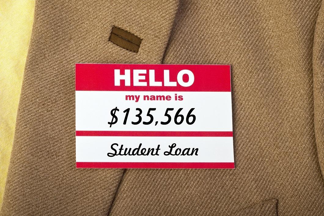 Student loan name badge on jacket.
