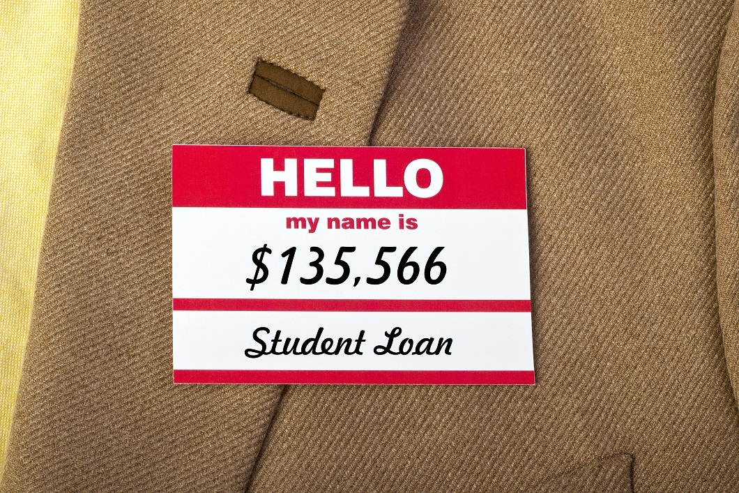 Student loan name badge on jacket.