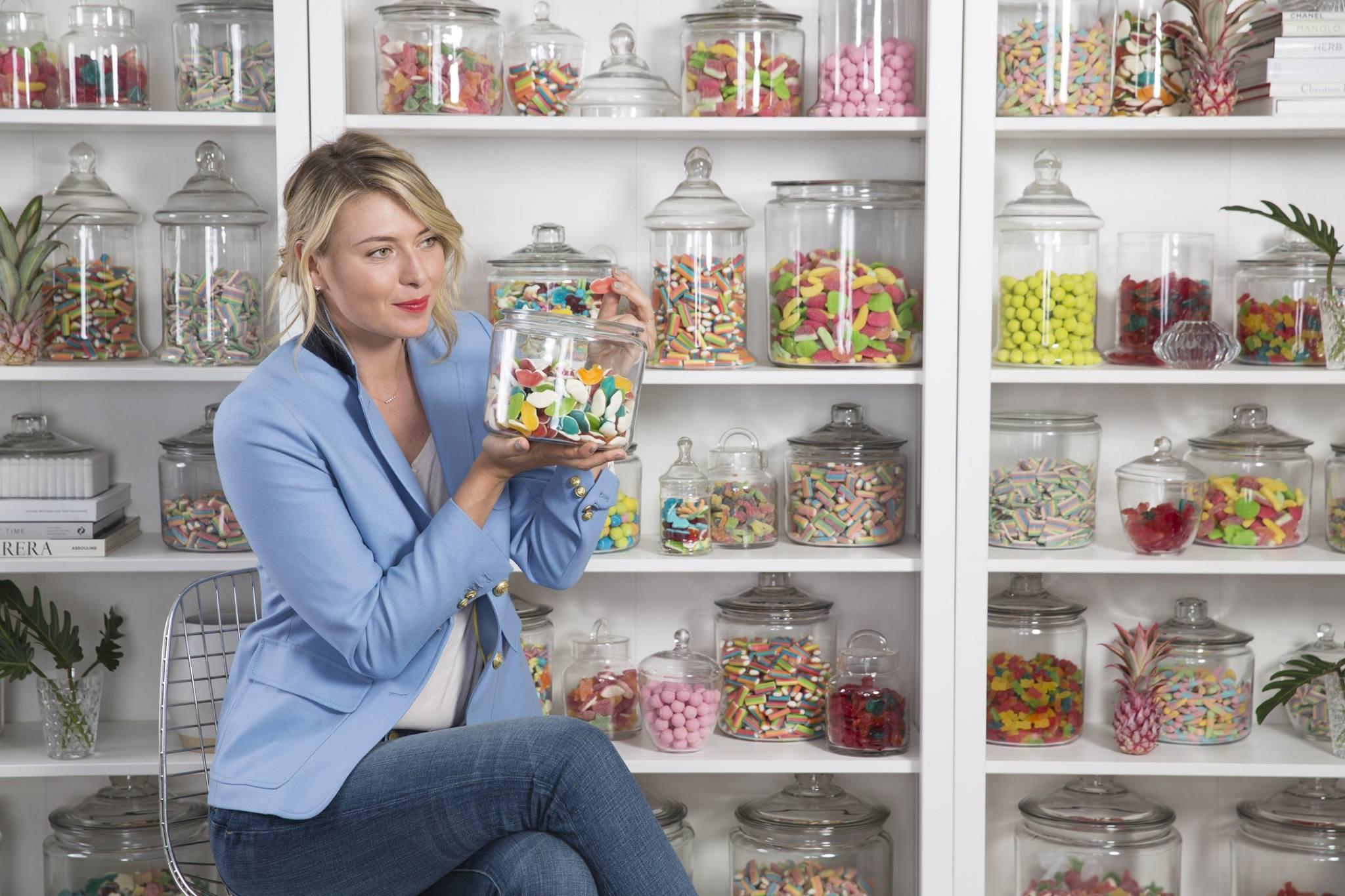 Maria Sharipova with jars of candy