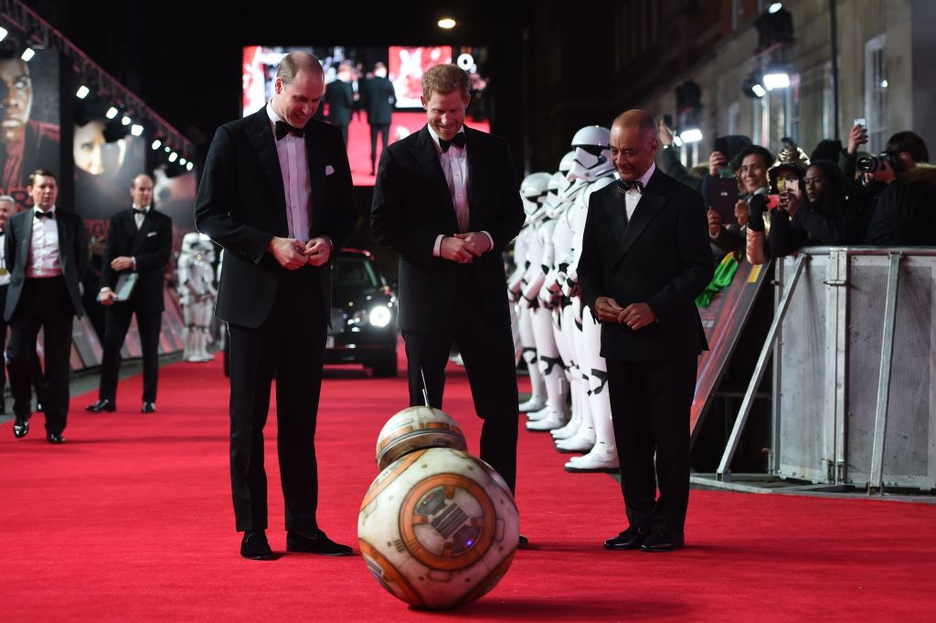 Britain's Prince William Duke of Cambridge and Prince Harry are greeted by droid BB-8 as they arrive for the European Premiere of Star Wars