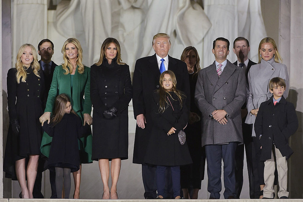US President-elect Donald Trump and family pose at the end of a welcome celebration