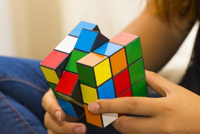 This classic Rubik's Cube is a 3-D mechanical puzzle