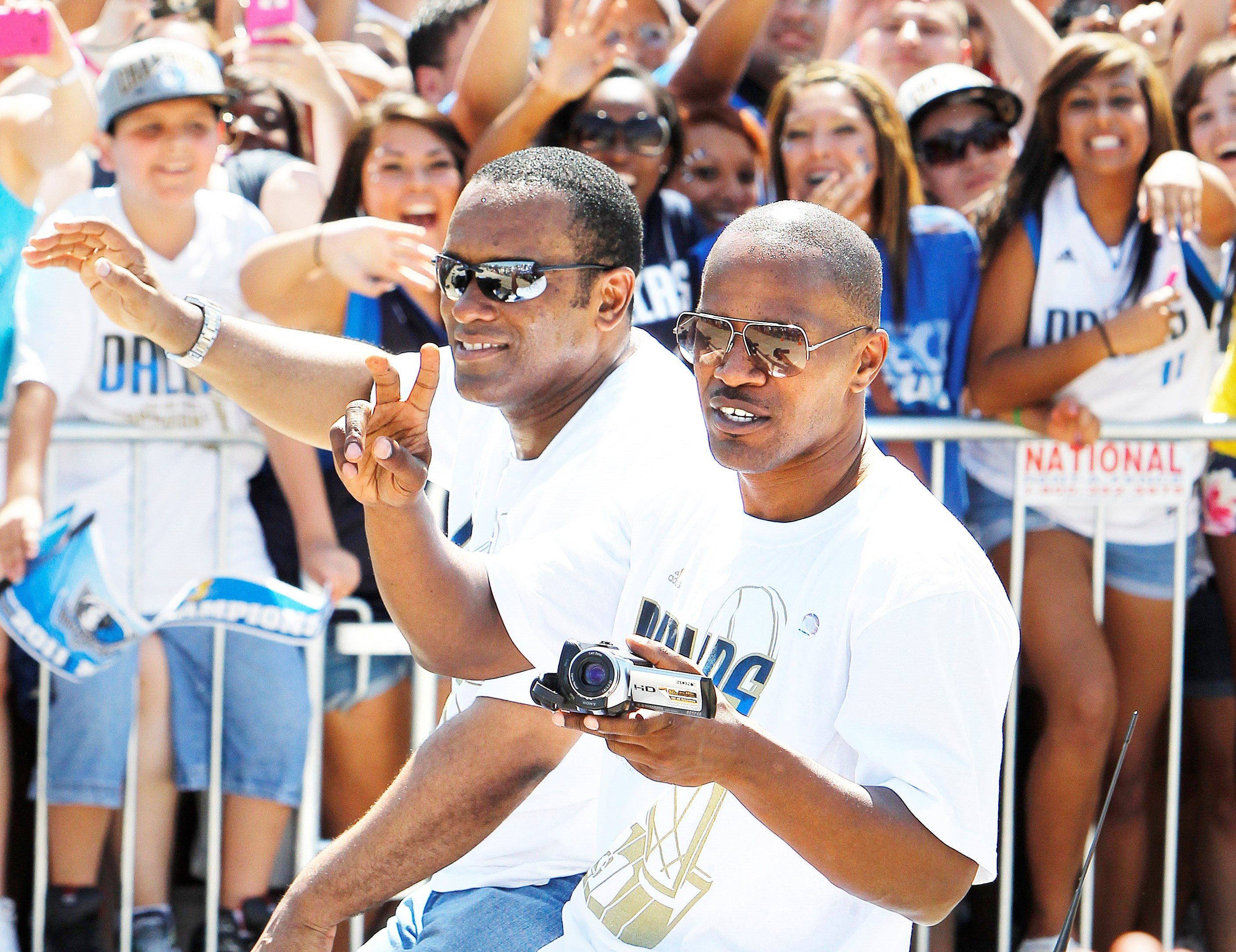 CEO of the Dallas Mavericks Terdema Ussery, left, and actor Jamie Foxx, right, during the Dallas Mavericks Victory Parade