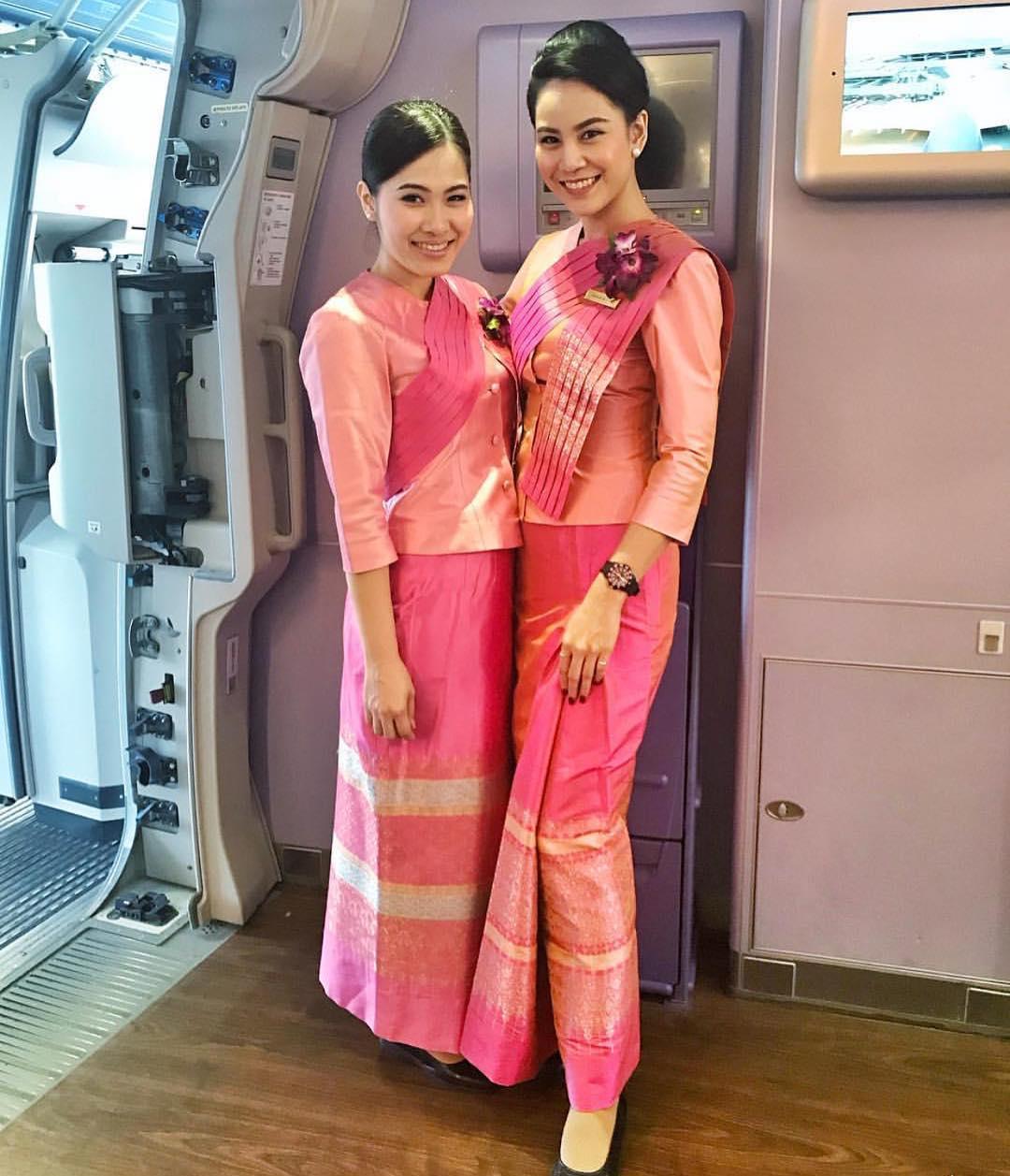 Thai Airways flight attendants in traditional thai dresses