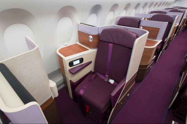 Purple seats in the Thai airways first class section.