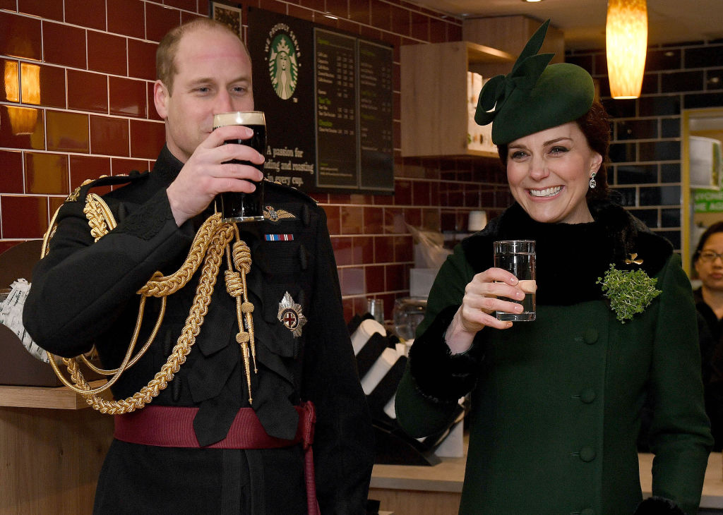 Prince William, Duke Of Cambridge, Colonel of the Irish Guards drinks a pint of Guinness next to Catherine, Duchess of Cambridge