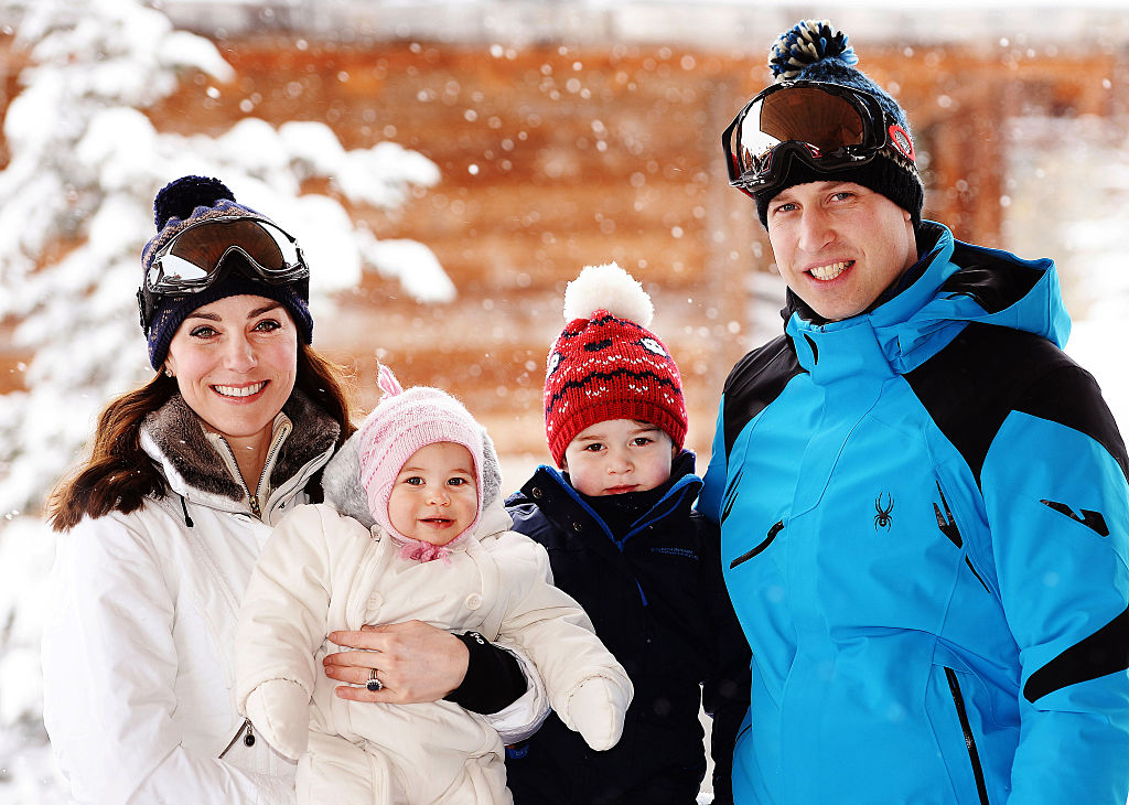 Catherine, Duchess of Cambridge and Prince William, Duke of Cambridge, with their children, Princess Charlotte and Prince George, enjoy a short private skiing
