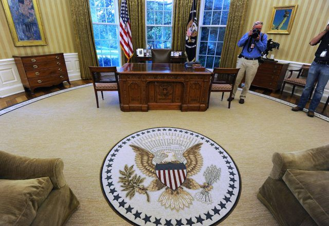 The Oval Office of the White House with redecorations of its carpet, couches and wallpaper.
