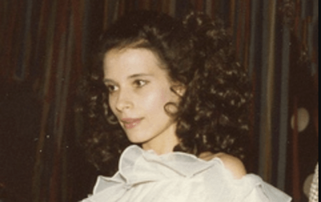 Theresa Saldana wearing a white dress.