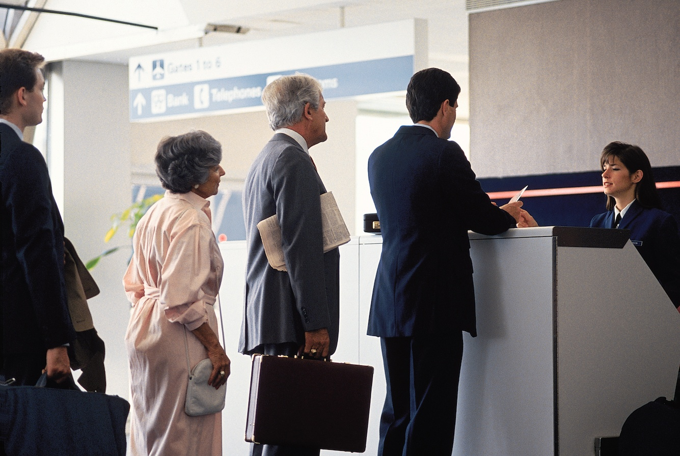 Travelers boarding an airplane