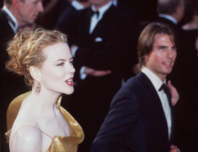 Nicole Kidman and Tom Cruise walking together on a red carpet.