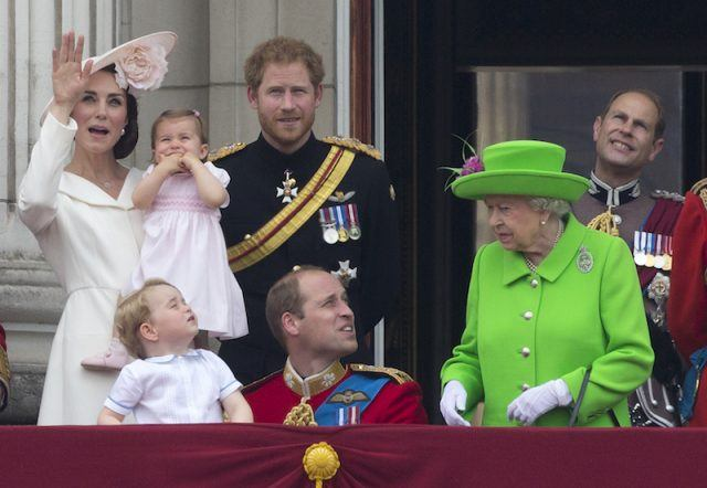 Prince William looking over at Queen Elizabeth.