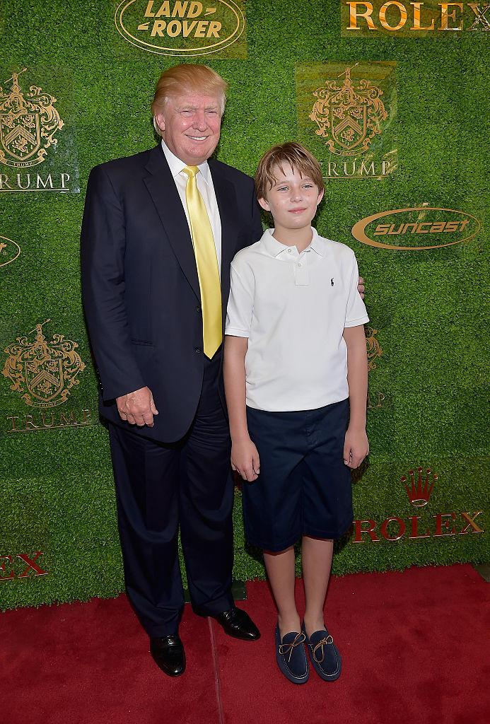 Donald Trump and Barron Trump attends Trump Invitational Grand Prix Mar-a-Lago Club