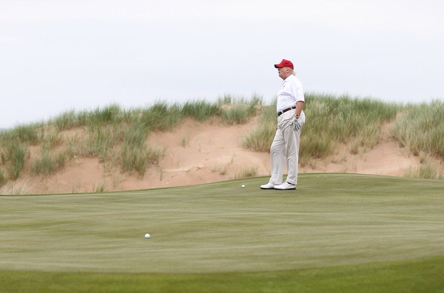Donald Trump plays a round of golf